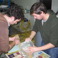 January 2011 January 2011 - But gool ol' Nicole, from the Ozeaneum in Stralsund / Germany, came to the rescue and got all our remnant fish from us, which means João Chambel (left) and Nuno Rodrigues (right) had to pull an all-nighter to bag them and have them delivered to the airport at the crack of dawn.