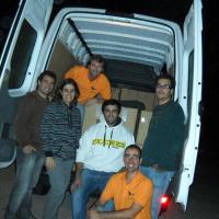 October 2010 October 2010 - At precisely 6 AM the team was done and got a photo of themselves, with all 44 boxes behind them and lots of taurine in their systems! Many thanks to Diogo and Pedro (middle and right), who also came to give us a hand.