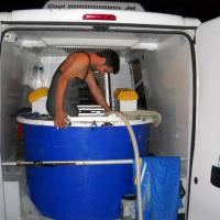 March 2012 Once we got to Múxia, way far north in Spain, our man Rúben stripped to his waders and crawled inside the transport tanks to pull out the Soles. Holy smokes, that was brave because it was freakin' freezing that night!